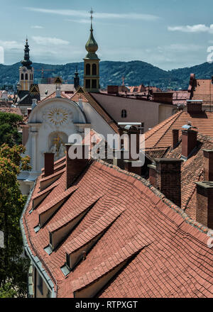 View of the old town center of Graz with the church Dreifaltigkeitskirche in the middle from the staircase of Castle Schlossberg Hill. Graz, Austria - Stock Photo