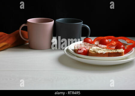Breakfast sandwiches and coffee on the table - Stock Photo