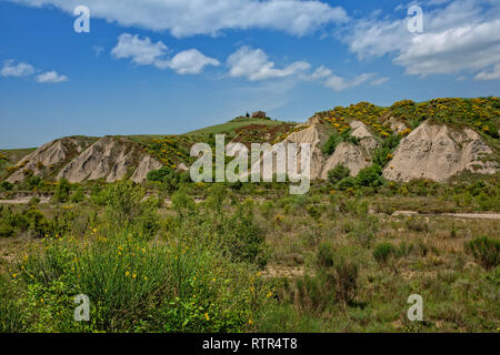 View of the Crete Senesi country landscape with a old ruin. Crete Senesi landscape erosion forms of Calanchi near Siena, Tuscany, Italy - Stock Photo