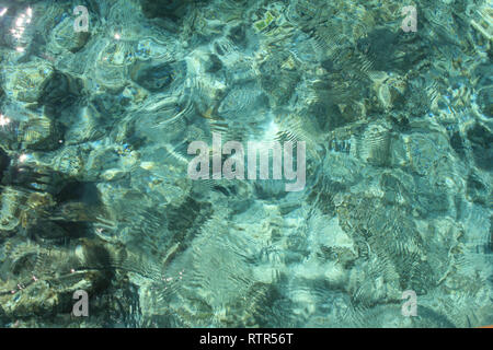Shimmering Sea in the Shallows - Stock Photo
