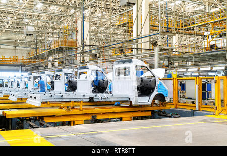 Car production line, skilled workers are working tense. - Stock Photo