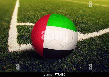 United Arab Emirates ball on corner kick position, soccer field background. National football theme on green grass. - Stock Photo