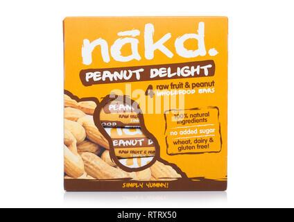 LONDON, UK - MARCH 01, 2019: Pack of NAKD Raw Fruit and Nut Wholefood Bars with Peanut on white. - Stock Photo