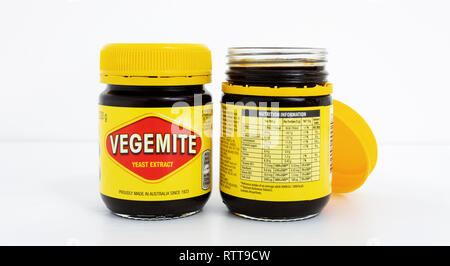 Prague, CZECH REPUBLIC - February 28, 2019: A studio shot of a 220g jars of Vegemite on white desk in front of white wall. Vegemite is a very popular  - Stock Photo