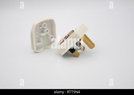 A UK Standard 3 PIN Plug with 13amp fuse, and the rear protective panel removed. - Stock Photo