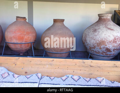 Ancient Roman Amphorae stacked up against a wall. These were used for carrying wine.  - Stock Photo