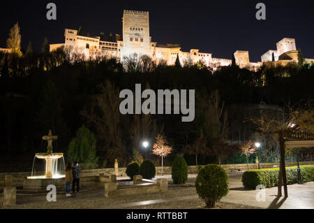 Alhambra in Granada, Spain as seen from Paseo de los Tristes - Stock Photo