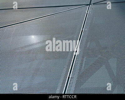 Seams Of Perforated Metal Panels On Facade - Stock Photo