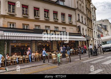 People sitting outside Le Saint-Jean café restaurant  on rue des Abbesses in Montmartre ,Paris ,France - Stock Photo