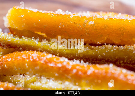 macro image of home made candied orange peel with large sugar granules - Stock Photo