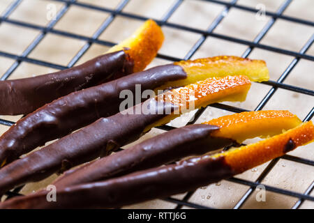 macro image of home made candied orange peel dipped in chocolate - Stock Photo