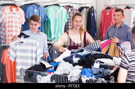 6b2e9d0a2b positive people of different ages buying clothes at the outlet store ...