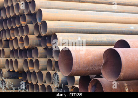 Rusty steel pipes, chinese steelworks in Europe. constructional elements. - Stock Photo