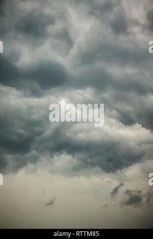 Dark stormy clouds background. Dramatic stormy sky with dark heavy clouds. - Stock Photo