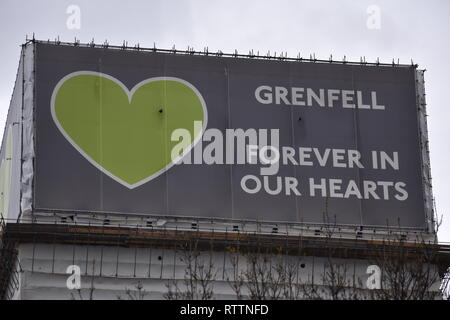 Grenfell Forever in Our Hearts. The Grenfell Inquiry continues this year; renovation and repair is ongoing in the fire damaged tower block of flats. - Stock Photo