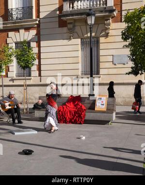 Flamenco dancer & guitarist busking on a Seville street Spain 3.2.19 - Stock Photo