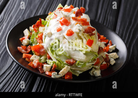 Wedge Salad with Blue Cheese, tomato and Bacon closeup on a plate on the table. horizontal - Stock Photo