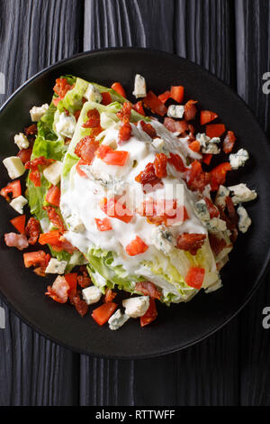 Wedge Salad with Blue Cheese, tomato and Bacon closeup on a plate on the table. Vertical top view from above - Stock Photo