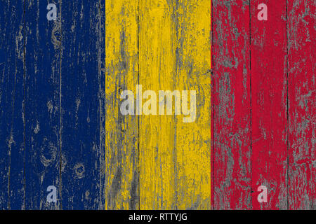 Flag of Chad painted on worn out wooden texture background. - Stock Photo