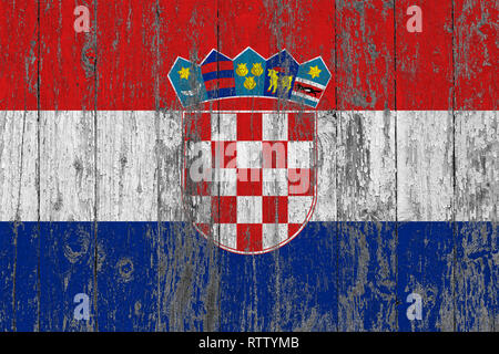 Flag of Croatia painted on worn out wooden texture background. - Stock Photo