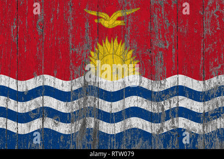 Flag of Kiribati painted on worn out wooden texture background. - Stock Photo