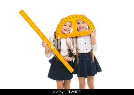 Having fun in school. Pupil cute girls with big rulers. School children with measuring instruments. Geometry favorite subject. Education and school concept. School students learning geometry. - Stock Photo
