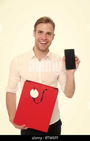 Hard earned cash and precious time you are spendings worth few minutes of preparation. Shopping online save time. Guy with smartphone and shopping bag happy purchase online. Shopping application. - Stock Photo