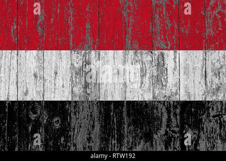 Flag of Yemen painted on worn out wooden texture background. - Stock Photo