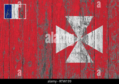 Flag of Wallis And Futuna painted on worn out wooden texture background. - Stock Photo