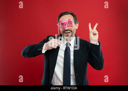 Guy enjoying party carnival. Holiday party celebration. Having fun. Office party corporate. Join carnival. Man formal suit wear fake glasses accessory. Cheerful businessman in party photo booth props. - Stock Photo
