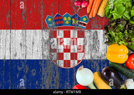 Fresh vegetables from Croatia on table. Cooking concept on wooden flag background. - Stock Photo