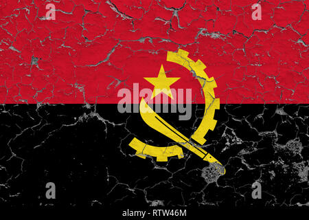 Flag of Angola painted on cracked dirty wall. National pattern on vintage style surface. - Stock Photo