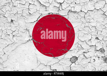 Flag of Japan painted on cracked dirty wall. National pattern on vintage style surface. - Stock Photo