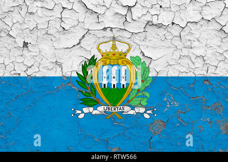 Flag of San Marino painted on cracked dirty wall. National pattern on vintage style surface. - Stock Photo