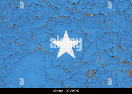 Flag of Somalia painted on cracked dirty wall. National pattern on vintage style surface. - Stock Photo