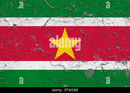 Flag of Suriname painted on cracked dirty wall. National pattern on vintage style surface. - Stock Photo