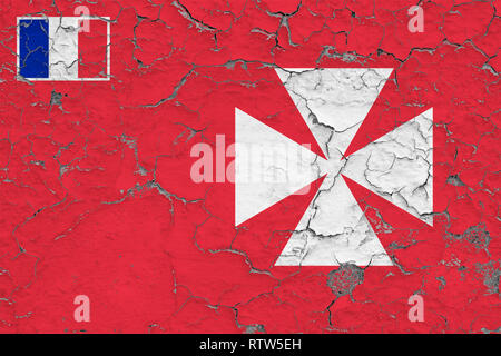 Flag of Wallis And Futuna painted on cracked dirty wall. National pattern on vintage style surface. - Stock Photo