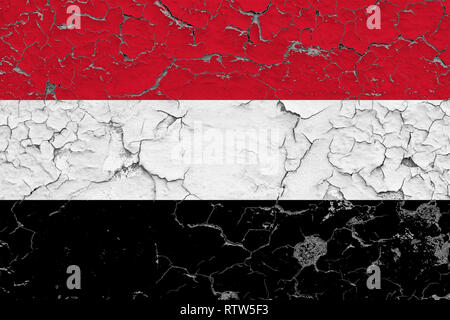 Flag of Yemen painted on cracked dirty wall. National pattern on vintage style surface. - Stock Photo