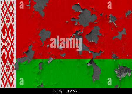 Close up grungy, damaged and weathered Belarus flag on wall peeling off paint to see inside surface. - Stock Photo