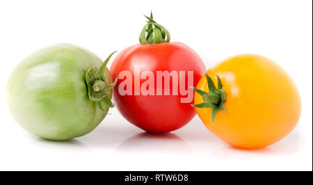 red yellow and green tomatoes isolated on white background - Stock Photo