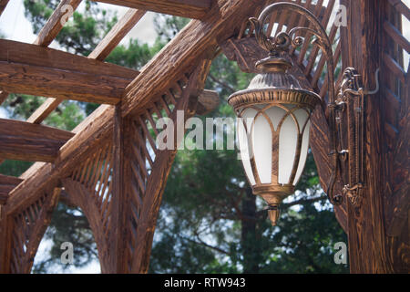 Vintage street light in the metal frame - Stock Photo