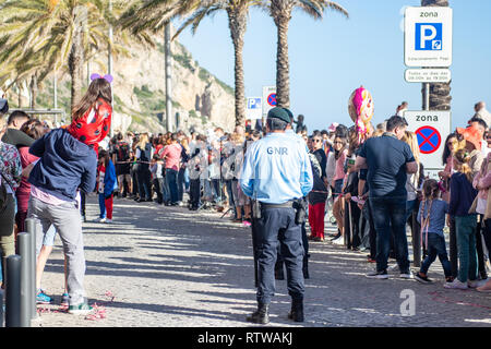Sesimbra, Portugal. 2nd March 2019. Weather: Carnaval de Sesimbra 2nd March 2019, Sesimbra, Portugal People came out in force today to celebrate the first carnival of the year Carnaval de Sesimbra and to enjoy the glorious sunshine on the seafront. The local GNR officers are out and about making sure everyone has a safe and fun time. Credit: Veteran Photography/Alamy Live News - Stock Photo