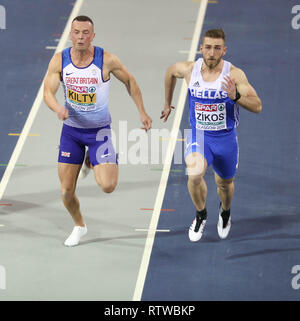 Glasgow, UK. 2nd March 2019. Richard Kilty (GBR) tries to out sprint Konstadinos ZIKOS (GRE) of Greece as they cross the line neck and neck the race was eventually won by Zikos Credit: Ben Booth/Alamy Live News - Stock Photo