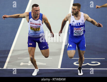 Glasgow, UK. 2nd March 2019. Richard Kilty (GBR) looks to Konstadinos ZIKOS (GRE) of Greece as they cross the line neck and neck the race was eventually won by Zikos Credit: Ben Booth/Alamy Live News - Stock Photo