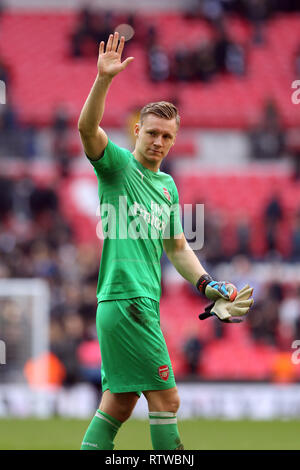 Wembley Stadium, London, UK. 2nd March 2019.   Bernd Leno of Arsenal thanks the Arsenal fan for the support during the Premier League match between Tottenham Hotspur and Arsenal at Wembley Stadium on March 2nd 2019 in London, England. Credit: PHC Images/Alamy Live News Credit: PHC Images/Alamy Live News - Stock Photo