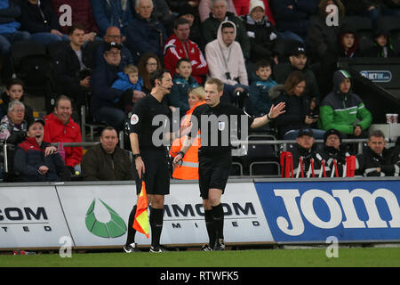 Swansea, Wales, UK. 2nd March, 2019. referee Gavin Ward (right) speaks to his assistant before sending off David Wheater of Bolton Wanderers (not in pic). EFL Skybet championship match, Swansea city v Bolton Wanderers at the Liberty Stadium in Swansea, South Wales on Saturday 2nd March 2019.  this image may only be used for Editorial purposes. Editorial use only, license required for commercial use. No use in betting, games or a single club/league/player publications. pic by Andrew Orchard/Andrew Orchard sports photography/Alamy Live news - Stock Photo
