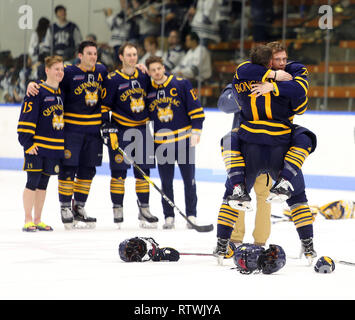 New Haven, CT, USA. 2nd Mar, 2019. March 2, 2019 - New Haven, Connecticut, USA: Quinnipiac #11 WYATT BONGIOVANNI gets a hug from Quinnipiac #29 ODEEN TUFTO after Quinnipiac's 4-1 win over Yale clinched the Bobcats regular season championship, and makes them the No. 1 overall seed in the 2019 ECAC Hockey Tournament. Games between the two schools, who are 8 miles from each other in Connecticut, have been a heated rivalry since to two teams played for a national championship in 2013, which was won by Yale 4-0. Stan Godlewski/ZUMA Press Credit: Stan Godlewski/ZUMA Wire/Alamy Live News - Stock Photo
