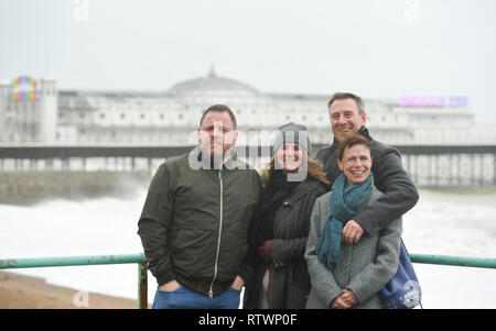 Brighton, East Sussex, UK. 3rd March 2019 .These visitors from London and Bristol were determined to enjoy a walk on Brighton seafront today despite the high winds as Storm Freya arrived and started to batter parts of Britain today Credit: Simon Dack/Alamy Live News - Stock Photo