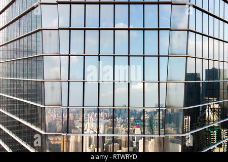 Glass Facade Corner and Reflection Of Skyline of Modern City. Skyline Reflected on Curtain Wall Elevation. - Stock Photo