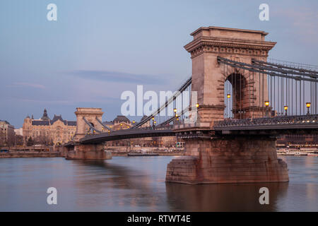 Evening at the Chain Bridge across the Danube in Budapest, Hungary. - Stock Photo